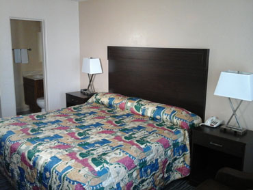 clean comfortable hotel room with one king size bed